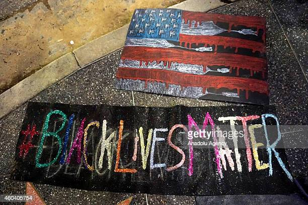 Peaceful protesters gather on Hollywood Boulevard to protest the jury decisions not to indict police officers involved in the deaths of black people...