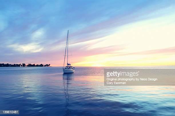 Peaceful sailboat at sunset