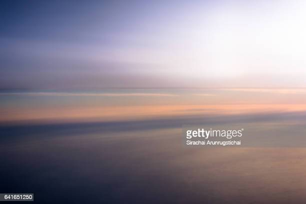 peaceful scene above the clouds - horizon over land stockfoto's en -beelden