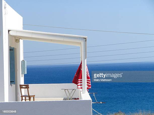 CONTENT] Peaceful villa balcony overlooking the red beach in Akrotiri Santorini Greece