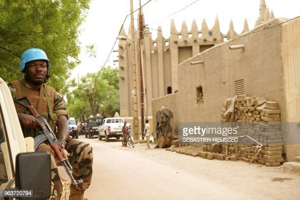 A peacekeeper by the United Nations patrols outside the mosque in Mopti central Mali during the visit of the United Nations General Secretary on May...
