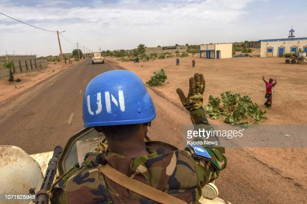 Peacekeeper from Bangladesh waves to a local resident from an armored vehicle in Gao, Mali, on Nov. 7, 2018. ==Kyodo