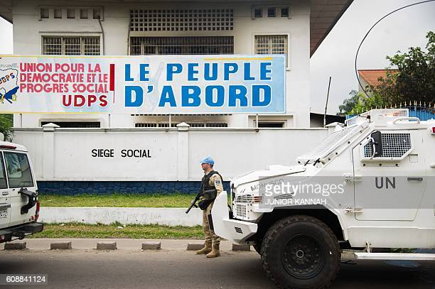 A peacekeeper of the MONUSCO the UN mission in the Democratic Republic of Congo stands guard on September 20 2016 in front of the offices of the main...