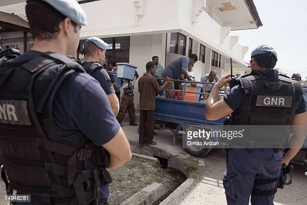 Peacekeeper police from Portugal guard the distribution of ballot boxes amidst high tension one day before elections June 29 2007 in Dili East Timor...