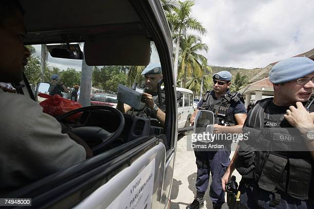Peacekeeper police from Portugal patrol the streets amidst high tension one day before elections June 29 2007 in Dili East Timor East Timorese people...