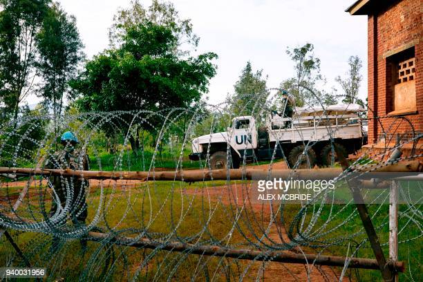 Peacekeeper stands guard at a newly established base in the Djugu area of Ituri on March 27, 2018. Recent conflict between members of the Lendu and...