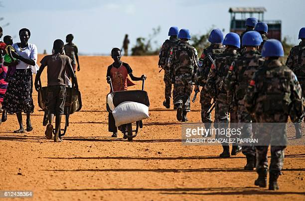 Peacekeeper troops from China deployed by the United Nations Mission in South Sudan patrol on foot outside the premises of the UN Protection of...