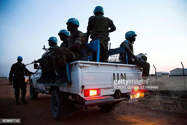Peacekeeper troops from Ethiopia and deployed in the United Nations Interim Security Force for Abyei patrol in a UN vehicle at night in Abyei town...