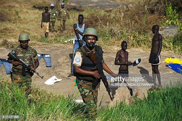 Peacekeeper troops from Ethiopia deployed by the United Nations Mission in South Sudan patrol on foot outside the premises of the UN Protection of...