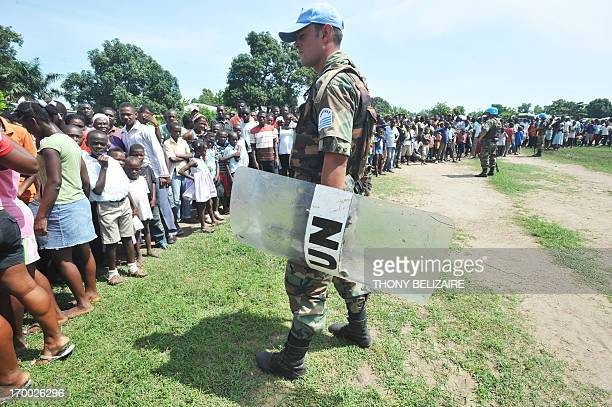 UN Peacekeepers control the crowd in Ouanaminthe Haiti on the occasion of the World Environment Day on June 5 2013 Dominican President Danilo Medina...