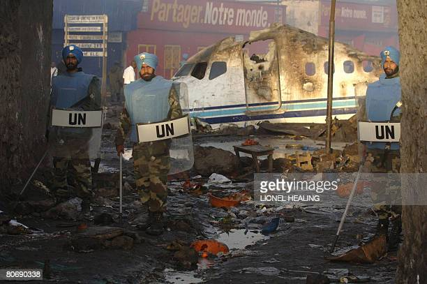 Peacekeepers from India guard the site of the Hewa Bora Airlines DC-9 jet crash on April 16 in Goma. The toll from a passenger jet which crashed into...