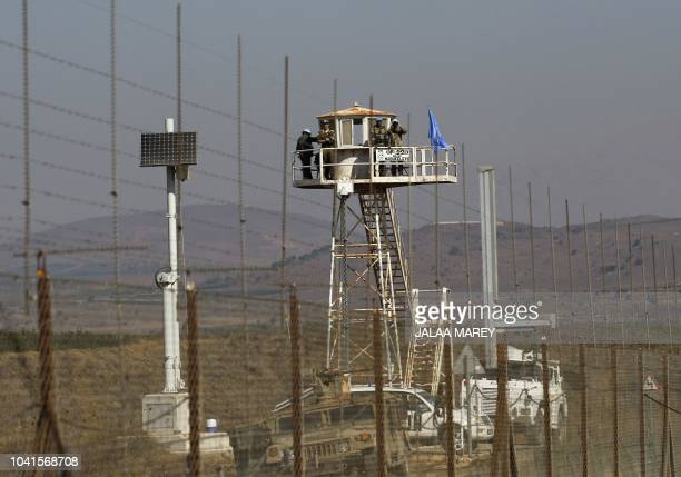 UN peacekeepers stand on a watch tower during a visit by the Israeli Defence Minister to the IsraelSyria border Quneitra crossing in the annexedGolan...