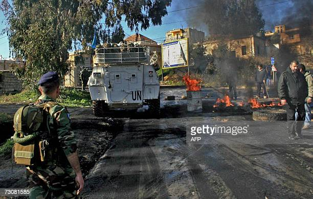 UN peacekeeping armoured vehicle drives past burned tires set ablaze by supporters of Hezbollahled opposition parties in the southern market town of...