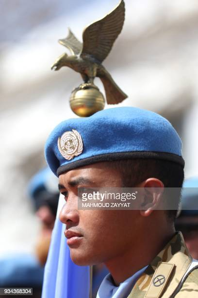 A UN peacekeeping force in Lebanon liaison attends the UNIFLIS's 40th anniversary celebration at its base in Lebanon's southern border town of Naqura...