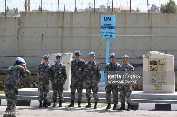 UN peacekeeping force in Lebanon liaison take a picture as they attend the UNIFLIS's 40th anniversary celebration at its base in Lebanon's southern...