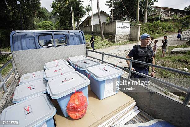 Peacekeeping police from Portugal guard ballot box distribution in the Lahane district amidst high tension one day before elections June 29 2007 in...