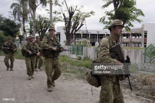 Peacekeeping soldiers from Australia patrol the street June 30 2007 in Dili East Timor East Timor goes to the polls for a third time this year in the...