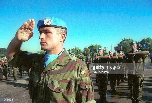 Peacekeeping soldiers from Portugal salute during a farewell ceremony May 17, 2002 in Dili, East Timor. The country will formally declare...