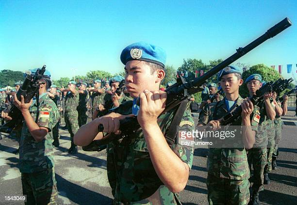 Peacekeeping soldiers from Singapore line up during a farewell ceremony May 17, 2002 in Dili, East Timor. The country will formally declare...