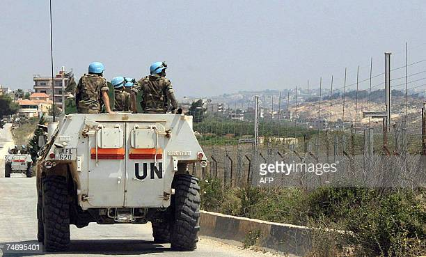 UN peacekeeping soldiers survey an area in the southern Lebanese village of Kafar Kila 18 June 2007 Lebanese troops battled militants on two fronts...