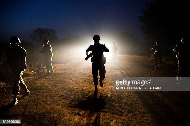 TOPSHOT Peacekeeper troops from Ethiopia and deployed in the United Nations Interim Security Force for Abyei patrol at night in Abyei town Abyei...