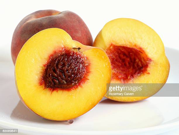 Peach and peach cut into two halves.