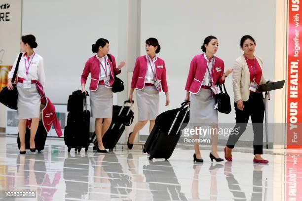 Peach Aviation Ltd cabin crew members walk through Terminal 2 of Kansai International Airport in Izumisano Osaka Prefecture Japan on Friday Sept 7...