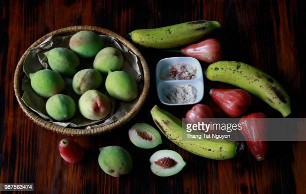 Peach  banana  rose apple in wooden background