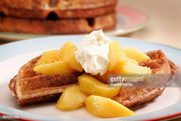 Peach cooked 'Sous–Vide' with yeast waffles and whipped cream