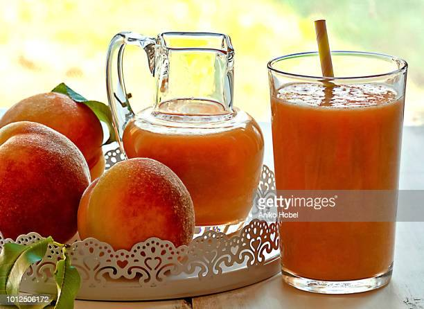 peach juice - aniko hobel stock pictures, royalty-free photos & images