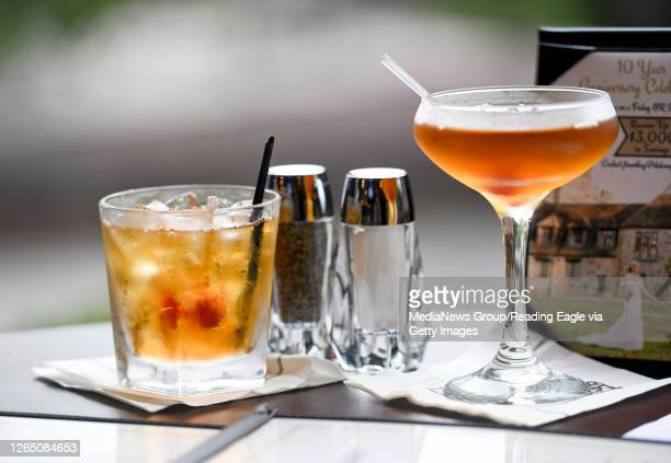 Peach Manhattans on a table at Stokesay Castle in Lower Alsace Township, PA Thursday evening August 6, 2020 where they have made renovations to the...
