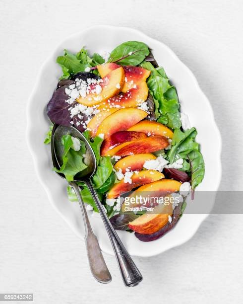 peach salad - salad bowl stock pictures, royalty-free photos & images