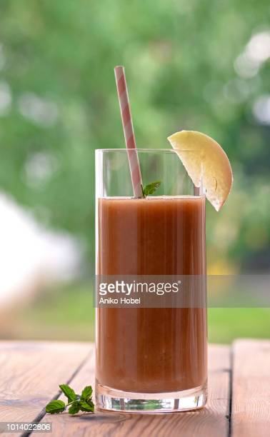 peach smoothie - aniko hobel stock pictures, royalty-free photos & images