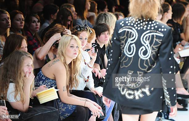 Peaches Geldof watches A model walking the runway during the TopShop Unique fashion show in the University of Westminster on 14 September 2008 in...