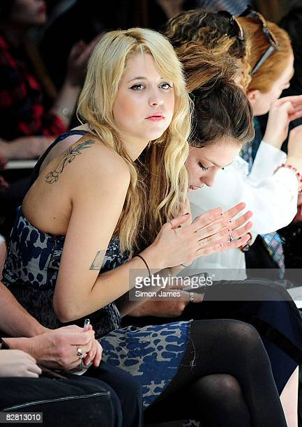 Peaches Geldof watches from the front row at the Topshop LFW Spring Summer 2009 runway show in the University Of Westminster on 14 September 2008 in...