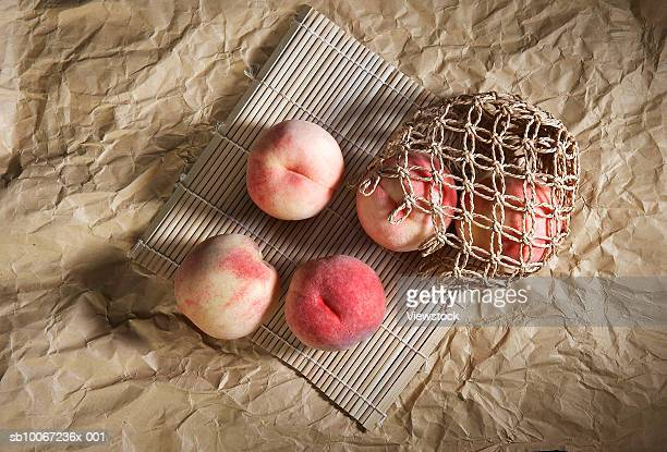 Peaches on brown paper, view from above