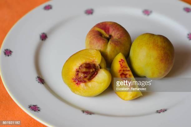 Peachs on plate