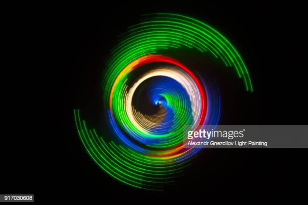 peacock colored abstract circular light painting - bildeffekt stock-fotos und bilder