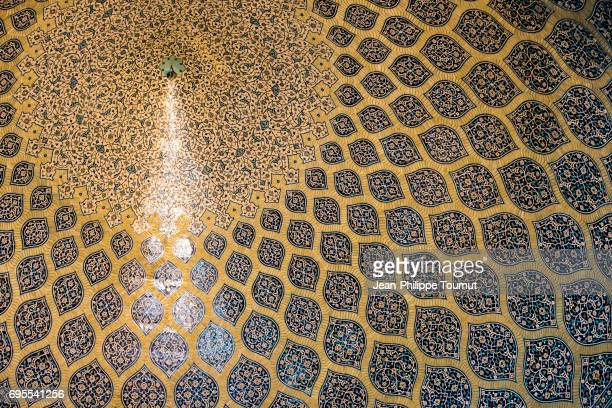'Peacock tail' light beam on the amazing tilework of the ceiling of Sheikh Lotfollah Mosque, Isfahan, Iran