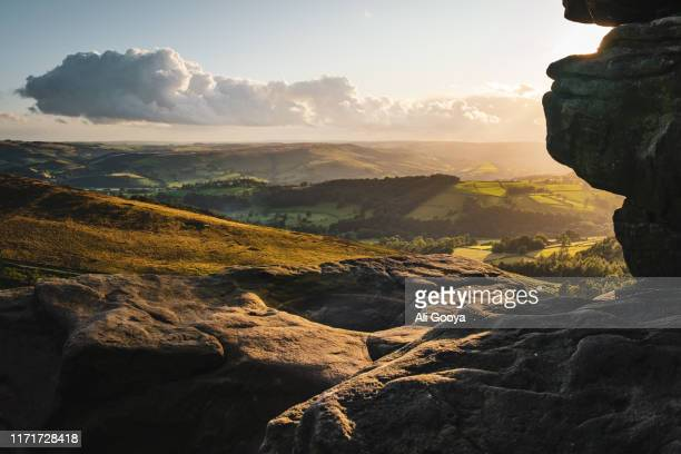 peak district over rocks with sunshine - sheffield stock pictures, royalty-free photos & images