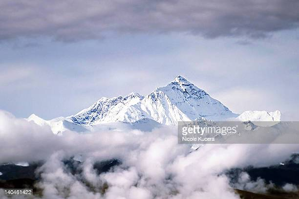 Peak of Mount Everest Above Clouds in Tibet