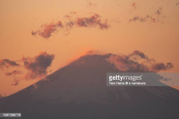 Peak of snow-capped Mt. Fuji in the sunset