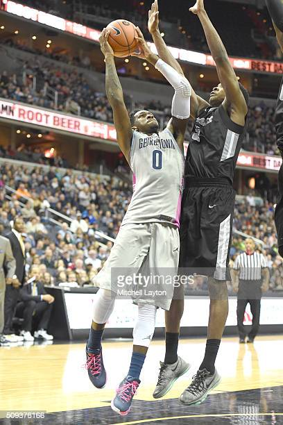 J Peak of the Georgetown Hoyas takes a shot over Rodney Bullock of the Providence Friars during a college basketball game at the Verizon Center on...