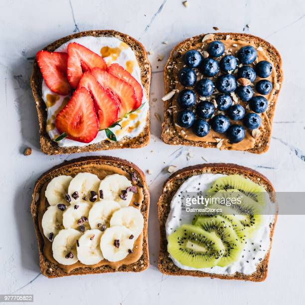 peanut butter and cream cheese toasts with fresh fruit - toasted bread stock pictures, royalty-free photos & images