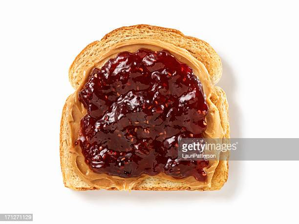 peanut butter and jam on toast - jam stock pictures, royalty-free photos & images