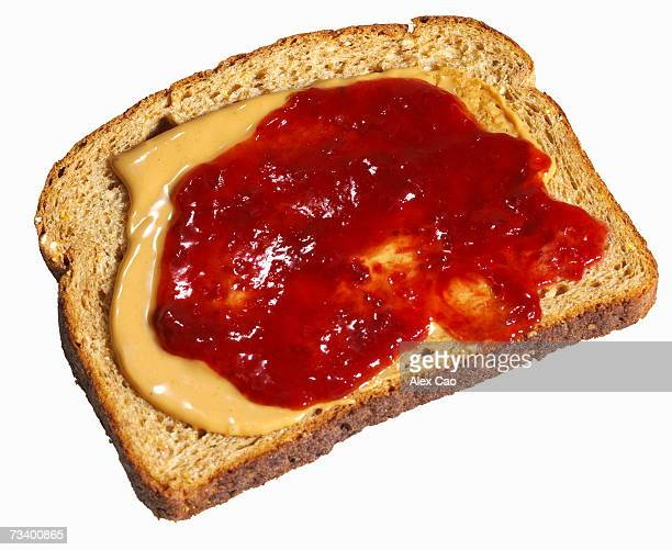 Peanut butter and jam on whole wheat slice of bread