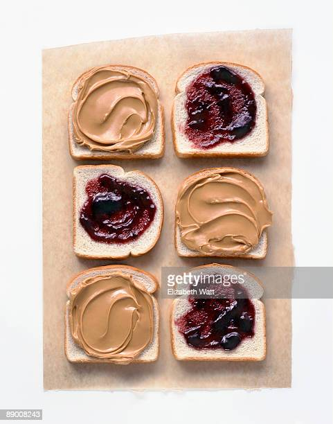 peanut butter and jelly on white bread - peanut butter and jelly sandwich stock pictures, royalty-free photos & images