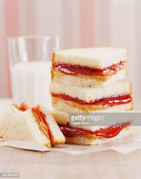 peanut butter and jelly sandwiches and a glass of milk - peanut butter and jelly sandwich stock pictures, royalty-free photos & images