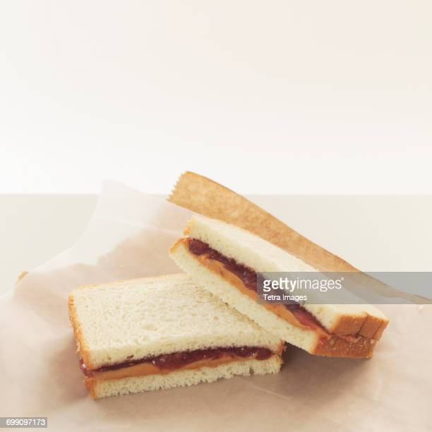 peanut butter and jelly sandwiches on wrapping paper - peanut butter and jelly sandwich stock pictures, royalty-free photos & images
