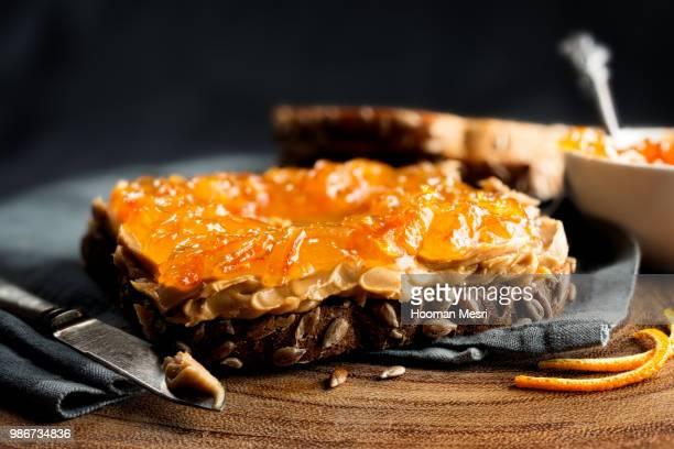 Peanut butter and orange marmalade on toast.